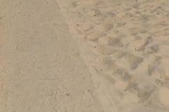 De textuur van het zand Bruin zand Achtergrond van fijn zand Gele kleurenversie Royalty-vrije Stock Afbeelding