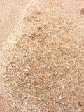 De textuur van het zandstrand Stock Fotografie