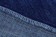 De textuur van jeans Blauwe Kleur Stock Afbeeldingen