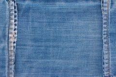 De textuur van jeans met naad Stock Afbeeldingen