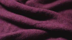 De textuur van modieus Bourgondië kleurde synthetische doek stock footage