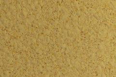 De textuur van de muren in schaduwen van geel royalty-vrije stock foto
