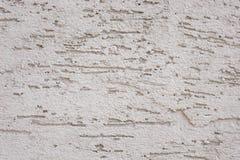 De textuur van de muur met krassen en barsten aan alle kanten royalty-vrije stock fotografie