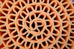 De textuur van oranje schuimblad rolde in golfvorm, gebruik als backgr stock foto
