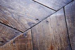 De textuur van oud hout in bruin met spijkers royalty-vrije stock foto
