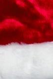 De textuur van rode en witte bonthoed van Santa Claus Royalty-vrije Stock Fotografie