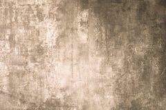 De textuur van steen en pleister is gouden kleur Natuurlijke concrete niveauoppervlakte Rechthoekig close-up, stock foto's