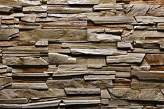 De textuur van steen groene brownwall natuurlijke kleur als achtergrond Stock Afbeeldingen