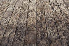 De textuur van de steenbestrating Het graniet cobblestoned bestratingsachtergrond stock afbeeldingen