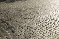 De textuur van de steenbestrating Het graniet cobblestoned bestratingsachtergrond Abstracte achtergrond van het oude close-up van royalty-vrije stock afbeelding