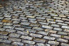 De textuur van de steenbestrating Het graniet cobblestoned bestratingsachtergrond stock foto