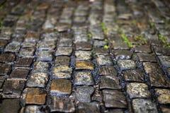 De textuur van de steenbestrating Het graniet cobblestoned bestratingsachtergrond stock fotografie