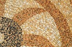 De textuur van de steenmuur, de weg van kleine ronde en ova stock fotografie