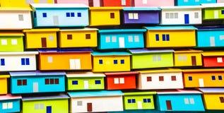 De textuur van de veelkleurige huizen heldere gebouwen stock foto's