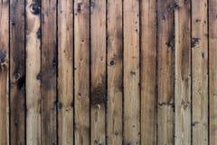 De textuur van de vergeelde houten planken Houten verticale omheining van gele raad royalty-vrije stock afbeeldingen