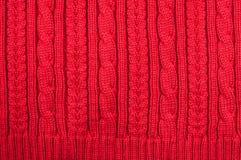 De textuur van wol breide rode strepen Stock Fotografie