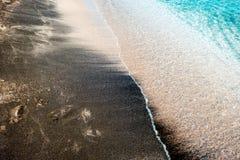 De textuur van zwart zand, conceptenachtergrond, natuurlijke achtergrond Stock Fotografie