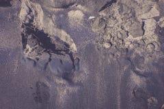 De textuur van zwart zand, conceptenachtergrond, natuurlijke achtergrond Stock Foto