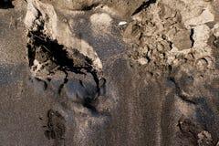 De textuur van zwart zand, conceptenachtergrond, natuurlijke achtergrond Stock Afbeeldingen