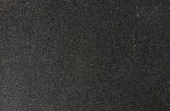 De textuur van zwart zand, conceptenachtergrond, natuurlijke achtergrond Royalty-vrije Stock Foto