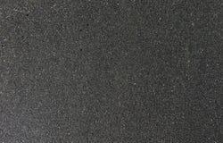 De textuur van zwart zand, conceptenachtergrond, natuurlijke achtergrond Royalty-vrije Stock Afbeeldingen