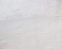 De textuurachtergrond stuccoed witte muur met netwerkbeton stock foto's