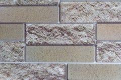 De textuurachtergrond van de baksteen decoratieve grijze muur stock afbeeldingen