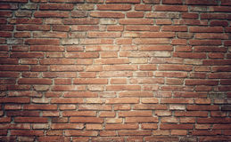 De textuurachtergrond van de Grungebakstenen muur met wijnoogst en vignet t Stock Foto's