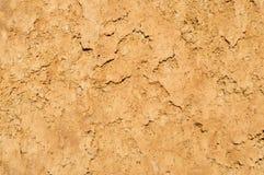 De textuurachtergrond van de kleigrond, droge oppervlakte Royalty-vrije Stock Fotografie