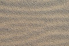 De textuurachtergrond van het zand Stock Foto