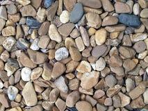 De textuurachtergrond van de kiezelsteensteen, overzeese stenen of rivierstenen voor tuindecor of weg Royalty-vrije Stock Foto's