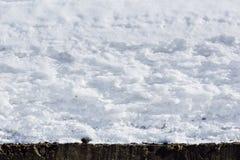 De textuurachtergrond van de sneeuwdekking sneeuw zoals slagroom Golven van sneeuw Stock Afbeelding