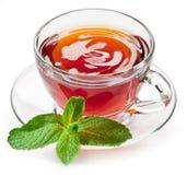 De thee van de kop met munt. stock afbeeldingen