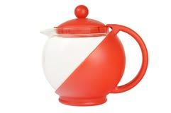 De theepot van het glas in rode bijlage Stock Foto