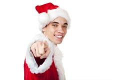 De tiener kleedde zich aangezien de Kerstman met vinger richt Royalty-vrije Stock Afbeeldingen