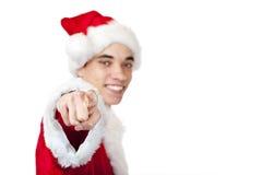 De tiener kleedde zich aangezien de Kerstman met vinger richt Stock Foto