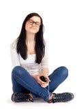 De tiener luistert muziek Stock Foto