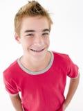 De tiener met dient zakken het glimlachen in stock fotografie