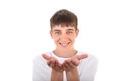 De tiener toont zijn Palmen royalty-vrije stock foto
