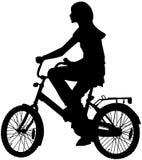 De tiener van het meisje op een fiets Stock Afbeelding
