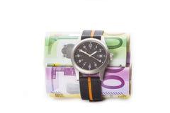 De tijd is geld, horloge en bankbiljetten Royalty-vrije Stock Afbeeldingen