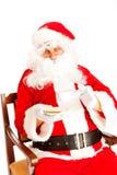 De tijd van de koffie voor de Kerstman Stock Foto