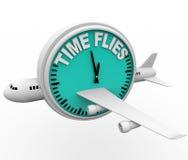 De tijd vliegt - Vliegtuig en Klok Stock Afbeeldingen