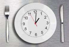 De tijdconcept van de lunch Stock Afbeeldingen