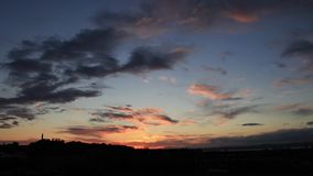 De tijdtijdspanne van Edinburgh als zon daalt stock videobeelden