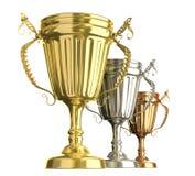 De toekenningskoppen van de winnaar: gouden zilver en bronstekens Stock Afbeeldingen