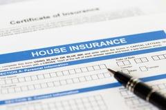 De toepassing van de huisverzekering met pen Stock Foto