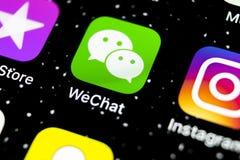 De toepassingspictogram van de Wechatboodschapper op Apple-iPhone X het close-up van het smartphonescherm App van de Wechatboodsc stock fotografie