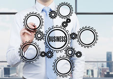 De toestellen van de zakenmantekening Stock Afbeelding