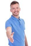 De toevallige jonge mens wil handen met u schudden stock fotografie